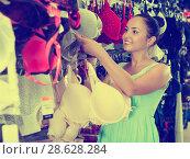 Купить «Woman buying brassiere», фото № 28628284, снято 19 июня 2017 г. (c) Яков Филимонов / Фотобанк Лори