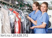 Купить «Two young women of laundry during daily work», фото № 28628312, снято 9 мая 2018 г. (c) Яков Филимонов / Фотобанк Лори