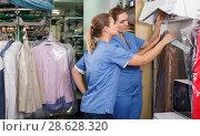 Купить «Two active workers of laundry during daily work», фото № 28628320, снято 9 мая 2018 г. (c) Яков Филимонов / Фотобанк Лори