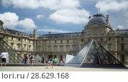 Купить «Louvre museum, Pyramids, fountain. Tourists walk on the square. Paris, France», видеоролик № 28629168, снято 7 июня 2018 г. (c) Ирина Мойсеева / Фотобанк Лори