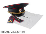 Купить «Police shoulder straps, cap and folder on a white background. The Russian text is a criminal case.», фото № 28629180, снято 18 мая 2016 г. (c) Александр Сергеевич / Фотобанк Лори
