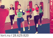 Купить «group of women different ages and their trainer are boxing in gym», фото № 28629820, снято 8 октября 2017 г. (c) Яков Филимонов / Фотобанк Лори