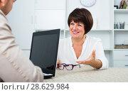 Купить «Blond man and businesswoman communicate», фото № 28629984, снято 23 июля 2018 г. (c) Яков Филимонов / Фотобанк Лори