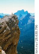 Купить «A mountaineer on a summit in the Italian Dolomites. Italy.», фото № 28630796, снято 19 сентября 2018 г. (c) Nature Picture Library / Фотобанк Лори