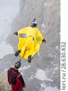 Купить «Base jumpers wearing wing suites jumping from the Aiguille Du midi above Chamonix, France. September 2014», фото № 28630832, снято 22 июля 2018 г. (c) Nature Picture Library / Фотобанк Лори