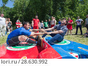 Купить «KAZAN, RUSSIA - JUNE 23, 2018: Traditional Tatar festival Sabantuy - Men fighting in national wrestling at summer day outdoors», фото № 28630992, снято 23 июня 2018 г. (c) Константин Шишкин / Фотобанк Лори