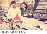 Купить «Couple examining various decorative materials», фото № 28644372, снято 9 марта 2017 г. (c) Яков Филимонов / Фотобанк Лори