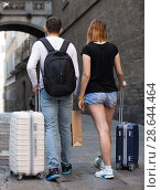 Купить «Family couple man and woman walking with baggage», фото № 28644464, снято 25 мая 2017 г. (c) Яков Филимонов / Фотобанк Лори