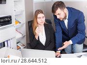 Купить «Manager scolding frustrated salesgirl», фото № 28644512, снято 9 апреля 2018 г. (c) Яков Филимонов / Фотобанк Лори