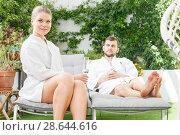 Купить «Young family in spa resort outdoors», фото № 28644616, снято 24 апреля 2018 г. (c) Яков Филимонов / Фотобанк Лори