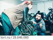 Купить «Man 20-29 years old is helping female client», фото № 28646080, снято 16 июля 2018 г. (c) Яков Филимонов / Фотобанк Лори