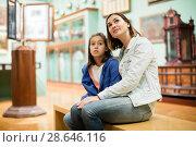 Купить «Mother and daughter exploring expositions», фото № 28646116, снято 19 июля 2018 г. (c) Яков Филимонов / Фотобанк Лори
