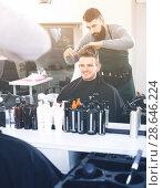 Купить «friendly guy stylist creating haircut for man client at hairdressing salon», фото № 28646224, снято 27 января 2017 г. (c) Яков Филимонов / Фотобанк Лори