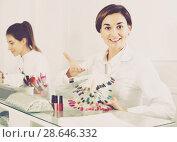 Купить «Female manicurist showing lacquer color schemes», фото № 28646332, снято 2 февраля 2017 г. (c) Яков Филимонов / Фотобанк Лори