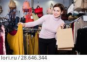 Купить «Woman choosing colorful blouse», фото № 28646344, снято 7 февраля 2017 г. (c) Яков Филимонов / Фотобанк Лори