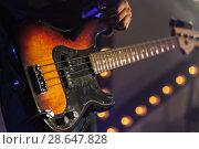 Купить «Bass guitar in guitarist hands», фото № 28647828, снято 11 декабря 2016 г. (c) EugeneSergeev / Фотобанк Лори