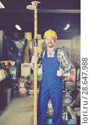 Купить «working man practicing his skills erect trestle at workshop», фото № 28647988, снято 17 января 2017 г. (c) Яков Филимонов / Фотобанк Лори