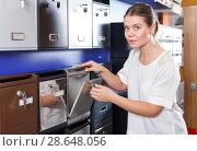 Купить «Woman choosing mailbox», фото № 28648056, снято 17 апреля 2018 г. (c) Яков Филимонов / Фотобанк Лори
