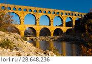 Купить «Pont du Gard, an ancient Roman bridge in southern France», фото № 28648236, снято 8 декабря 2017 г. (c) Яков Филимонов / Фотобанк Лори