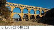 Купить «Roman Bridge Pont du Gard in autumn in South of France», фото № 28648252, снято 8 декабря 2017 г. (c) Яков Филимонов / Фотобанк Лори