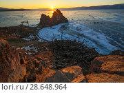 Купить «Olkhon island in early spring. Shaman rock and Baikal lake at sunset.», фото № 28648964, снято 16 июля 2018 г. (c) Владимир Пойлов / Фотобанк Лори