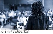 Купить «Public speaker giving talk at Business Event.», фото № 28653828, снято 3 июля 2014 г. (c) Matej Kastelic / Фотобанк Лори