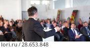 Купить «Public speaker giving talk at Business Event.», фото № 28653848, снято 16 июля 2018 г. (c) Matej Kastelic / Фотобанк Лори