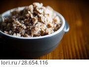 Купить «buckwheat boiled in a ceramic bowl», фото № 28654116, снято 26 июня 2018 г. (c) Peredniankina / Фотобанк Лори