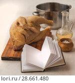 Купить «A book with a blank page on a background of raw goose carcasses», фото № 28661480, снято 12 января 2016 г. (c) Олеся Сарычева / Фотобанк Лори