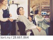 Купить «Woman happy with her haircut and young hairdresser», фото № 28661864, снято 7 марта 2017 г. (c) Яков Филимонов / Фотобанк Лори