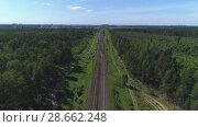 Купить «Two-track railway. The camera moves along the rail direction», видеоролик № 28662248, снято 16 июня 2018 г. (c) Андрей Радченко / Фотобанк Лори
