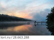 Купить «Летний пейзаж с рассветом над рекой и рыбаком ловящем рыбу», эксклюзивное фото № 28663288, снято 24 мая 2018 г. (c) Игорь Низов / Фотобанк Лори