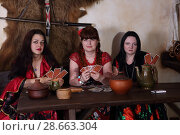 Купить «Три цыганки гадают на картах», фото № 28663304, снято 13 мая 2018 г. (c) Марина Володько / Фотобанк Лори