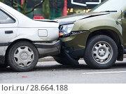 Купить «car crash accident on street, damaged automobiles after collision in city», фото № 28664188, снято 28 ноября 2017 г. (c) Дмитрий Калиновский / Фотобанк Лори