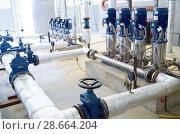 Купить «water pumping station. Valve faucet and pumps», фото № 28664204, снято 25 сентября 2017 г. (c) Дмитрий Калиновский / Фотобанк Лори
