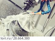 Купить «Milling metalworking process. Industrial CNC metal machining by vertical mill», фото № 28664380, снято 16 мая 2017 г. (c) Дмитрий Калиновский / Фотобанк Лори