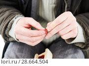 Купить «Fisherman adding mosquito grub on hook at winter fishing», фото № 28664504, снято 9 марта 2018 г. (c) Дмитрий Калиновский / Фотобанк Лори