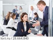 Upset girl sitting in coworking space while dissatisfied businessman. Стоковое фото, фотограф Яков Филимонов / Фотобанк Лори