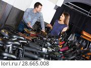 Купить «employee helping adult guy to select bike at rental agency», фото № 28665008, снято 15 октября 2018 г. (c) Яков Филимонов / Фотобанк Лори
