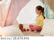 Купить «little girl playing tea party in kids tent at home», фото № 28674416, снято 18 февраля 2018 г. (c) Syda Productions / Фотобанк Лори