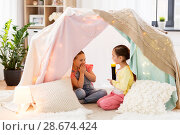 Купить «little girls with torch light in kids tent at home», фото № 28674424, снято 18 февраля 2018 г. (c) Syda Productions / Фотобанк Лори