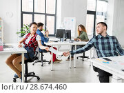 Купить «creative office workers with user interface mockup», фото № 28674460, снято 1 апреля 2018 г. (c) Syda Productions / Фотобанк Лори