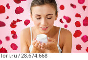 Купить «close up of woman smelling cream over rose petals», фото № 28674668, снято 9 апреля 2017 г. (c) Syda Productions / Фотобанк Лори