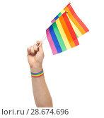 Купить «hand with gay pride rainbow flags and wristband», фото № 28674696, снято 2 ноября 2017 г. (c) Syda Productions / Фотобанк Лори