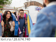 Купить «happy couple having fun at vintage clothing store», фото № 28674740, снято 30 ноября 2017 г. (c) Syda Productions / Фотобанк Лори