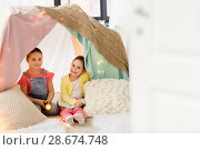 Купить «girls with book and torch in kids tent at home», фото № 28674748, снято 18 февраля 2018 г. (c) Syda Productions / Фотобанк Лори