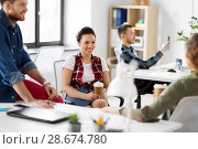 Купить «creative team drinking coffee at office», фото № 28674780, снято 1 апреля 2018 г. (c) Syda Productions / Фотобанк Лори