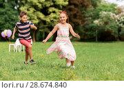 Купить «happy kids playing tag game at birthday party», фото № 28674840, снято 27 мая 2018 г. (c) Syda Productions / Фотобанк Лори