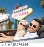Купить «couple driving in convertible car at las vegas», фото № 28674924, снято 15 июля 2015 г. (c) Syda Productions / Фотобанк Лори