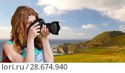 Купить «woman with backpack and camera at big sur coast», фото № 28674940, снято 25 июля 2015 г. (c) Syda Productions / Фотобанк Лори
